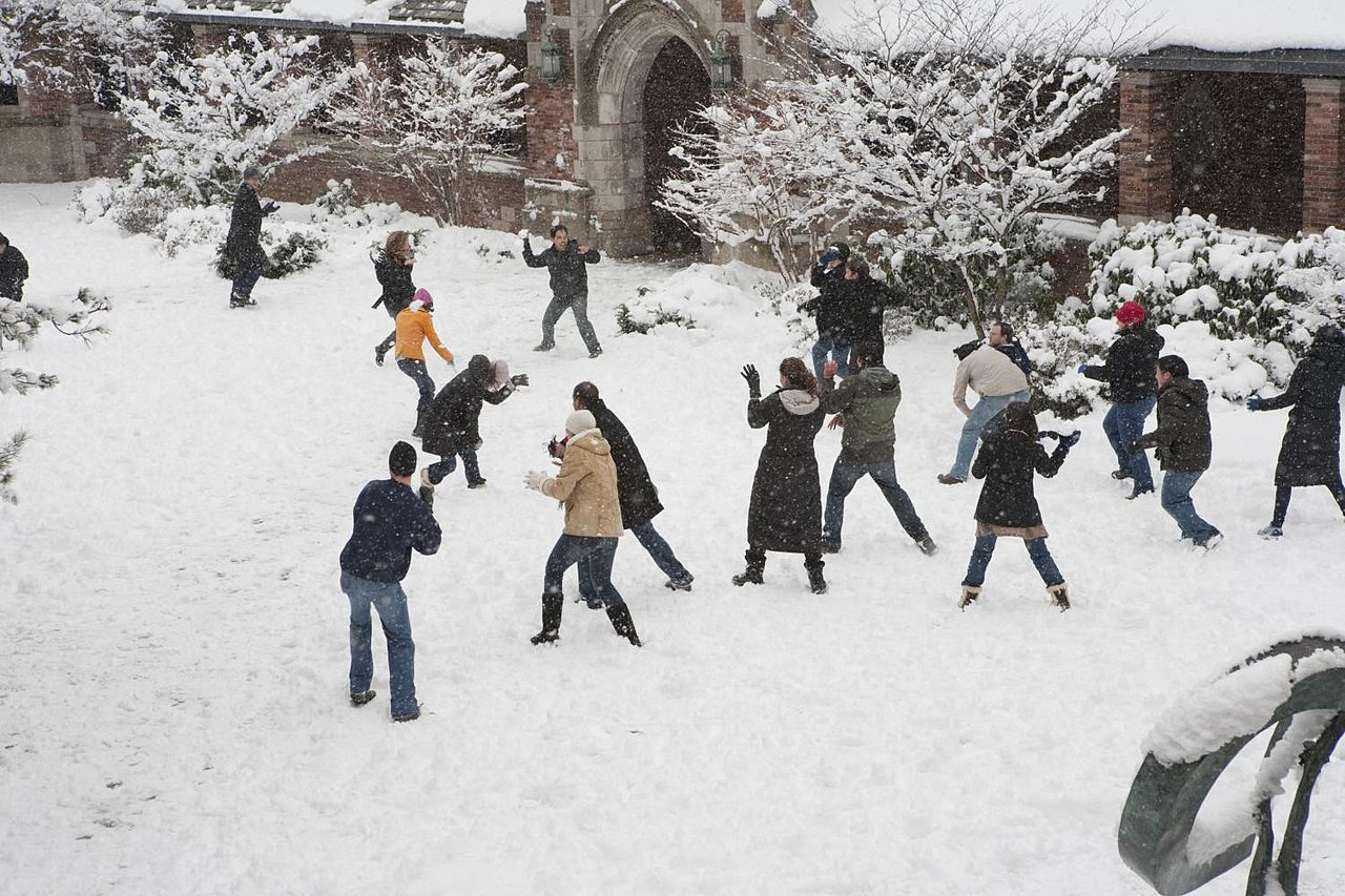 Snowball fight out in the courtyard