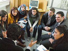 During a 2010 IRAP trip, students meet with Iraqi refugee.