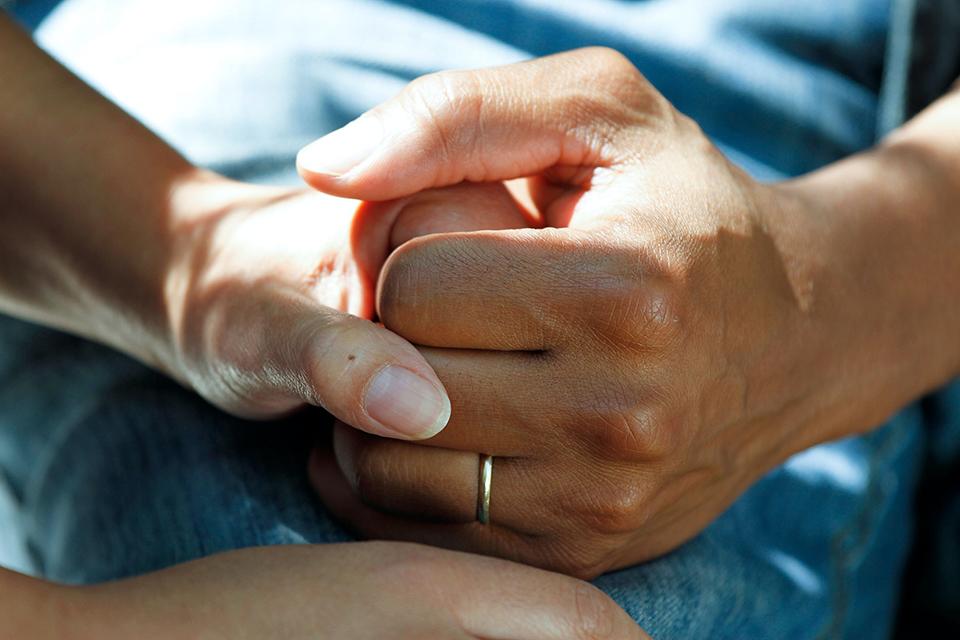 palliative care holding hands